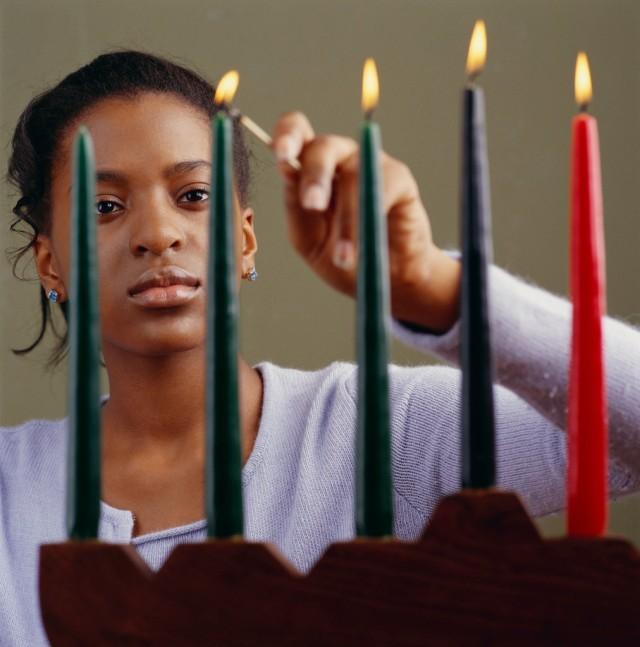 Young Woman Lighting Menorah Candles